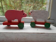 Two Xmas Small Wooden Hand Painted Ornaments - Pig and Sheep on Wheels