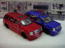 Cadillac Escalade Blue or Red with Black wheels 1:24th scale