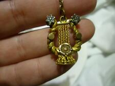 A89 Gold Filled Pocket Watch Clip with Chain and Ornament in Shape of a Lire.