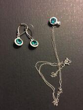White gold, emerald and diamond jewelry set