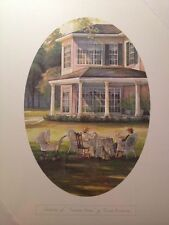 """Vignette of """"Summer Home"""" by Trisha Romance, oval, 12"""" x 16"""", table on grass"""