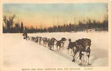 BEATTY DOG TEAM CARRYING MAIL FOR IDITAROD ALASKA HAND COLORED POSTCARD (c.1910)