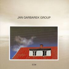 Jan Garbarek Group - Photo with Blue Sky, White Cloud, Wires, Windows and a R...