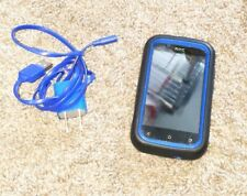 HTC One X - cdma Smartphone with blue accessories