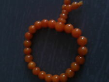 Bracelet boudhique en perles de jade teints orange 8mm, 1 rang.