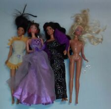 Mixed lot of four barbies glamorous  dolls fancy dresses Pocahontas earrings