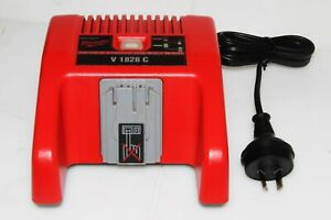 milwaukee genuine battery charger 18-28v v1828c perfect working order near new