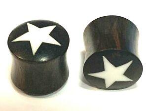 1 Pair of White Star Dark Wood Ear Plugs varied gauges