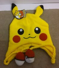 Bioworld Pikachu Beanie With Pokeball Tassles.  BRAND New with Tags.  One Size.