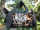 ANIMAL PRINT PURSE BY JUICY COUTURE