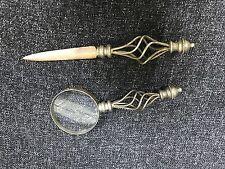 antique vintage magnifier glass and letter opener