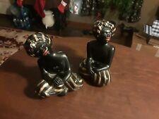 "A Set Of Two Black Memorabilia ceramic 5"" Candleholders"