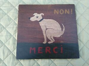 Hand painted wooden sign of French cartoon dog having a poo. No pooping plaque
