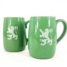 Vintage Coors Beer Lion Crest Green Ceramic Mug Cup Set 2 w Tassel Tail Logo Usa
