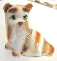 "2.5"" X 2.5"" CERAMIC MINIATURE FIGURINE OF A LOVELY SITTING PUPPY."