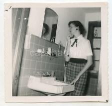 Woman Contemplates Reflection In Bathroom Mirror Vintage 1950s Photo
