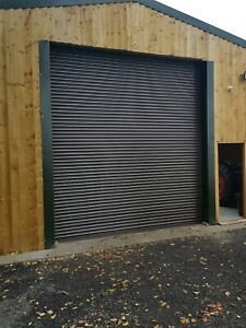 3m wide x 3m high electric single phase roller door coloured juniper