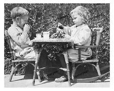 1910s era vintage photo-Little boy and girl-tea party-rocking chair-8x10 in