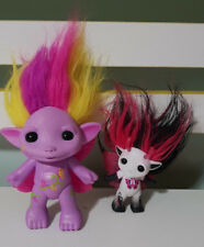 ZELF TOY PURPLE WITH BUTTERFLIES AND WHITE WITH DEVIL HORNS AND A BUTTERFLY!