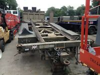 wagon drag skeletal drops. close couple hook loader trailer