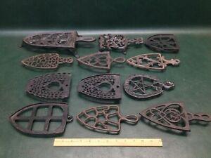 Lot of 12 Vintage & Antique Cast Iron Sad iron Trivets
