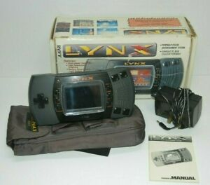 Atari Lynx console, boxed with instructions and 2 working games - WORKING