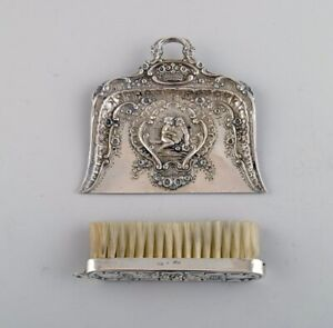 Antique table sweeping set in silver (835) with erotic motif. Approx. 1900.