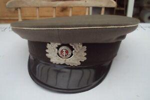 Vintage East German military officers cap with enamel badge.