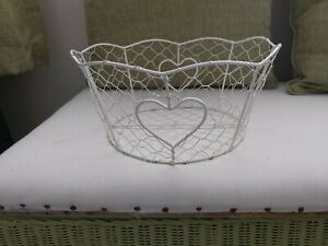 Shabby chic cream coloured round shaped wire basket with heart detail