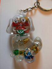 A Funky Dog Shaped Keyring With Coloured Floating Balls.