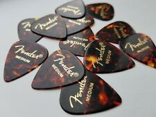24 x Fender Shell Heavy Classic Celluloid Guitar Picks In A Handy Pick Tin