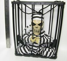 Screaming skeleton prison in a Cage with Lights Talking Halloween Decoration Y03