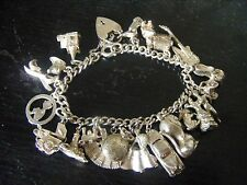 VINTAGE STERLING SILVER CHARM BRACELET WITH 20 SILVER CHARMS - APPROX. 62 grams