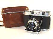 """Soviet camera ISKRA. Lens: INDUSTAR - 58 Red """"P"""" (3,5/75)."""