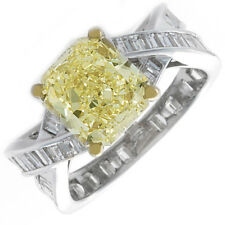 Elegant 5.50 Carat GIA Fancy Yellow Cushion Cut Diamond Engagement Ring in 18k