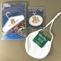 Lot of 3 baby cross stitch items blank Aida bib, hanger kit, teddy bear kit new