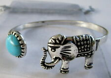 SILVER COLOURED METAL BANGLE WITH NATURAL BLUE STONE & LUCKY ELEPHANT! BRAND NEW