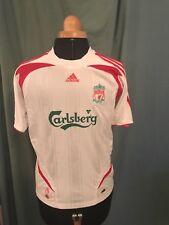 "Liverpool FC boys retro shirt. Size 30/32""    Sponsor Carlesberg."