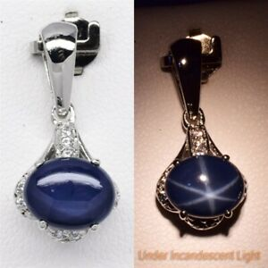 9x7mm Dark Blue Natural 6 Ray Star-Sapphire Pendant With Topaz in 925 Silver