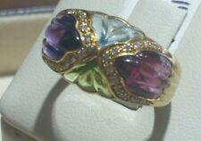 18k gold genuine color stone ring with diamonds.