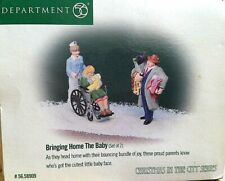 Dept 56~Christmas in the City Series~Bringing Home the Baby(set of 2)~#58909 Mib