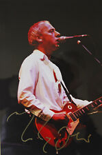 Original hand signed mounted photo of Mark Knopfler 12 x 8 inch by Mel Longhurst