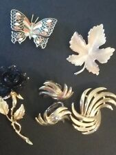 Antique brooch pin lot, clip on earing set. Gerry's black rose, Trifari set.