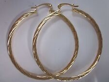 18 karat gold filled 2 3/8 inch designer large hoop earring with a twist