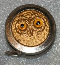RARE BRASS TAPE MEASURE, RELIEF OWL FACE WITH GLASS EYES