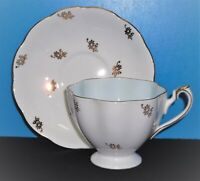 Vintage Queen Anne Bone China England Gold Floral Gilded Teacup and Saucer Set