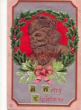 1910 A MERRY CHRISTMAS embossed Santa in a holly wreath