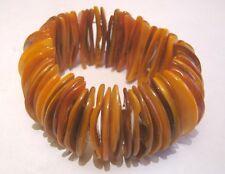 Lovely elasticated brown orange shell section bracelet
