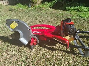 ATOM 580 Edger with Mitsubishi TLE33 Engine in great working condition
