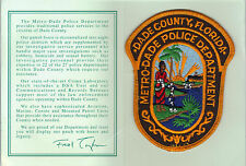 Metro-Dade Police (Florida) Shoulder Patch on a Dept. History Card from 1993